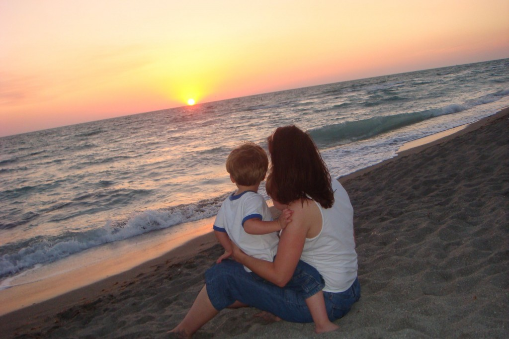 Shannon and her boys, on the beach at sunset