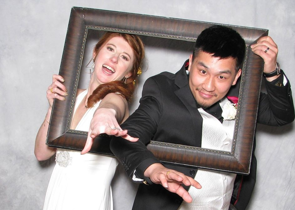 "Bride and groom in the ""photo booth."""
