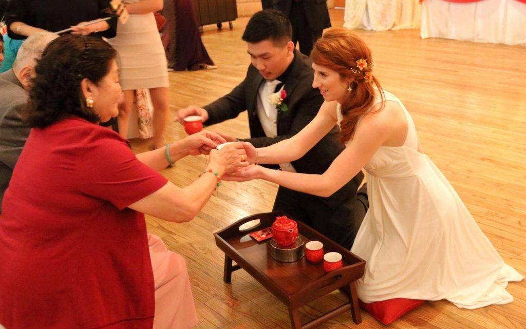 Bride and groom serving tea to groom's grandparents