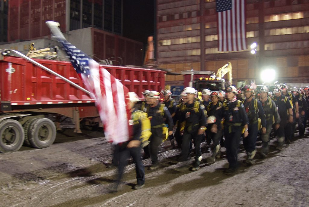 firfighters with flag