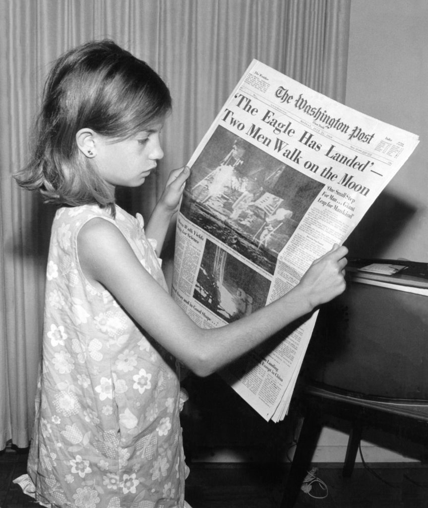 girl with newspaper