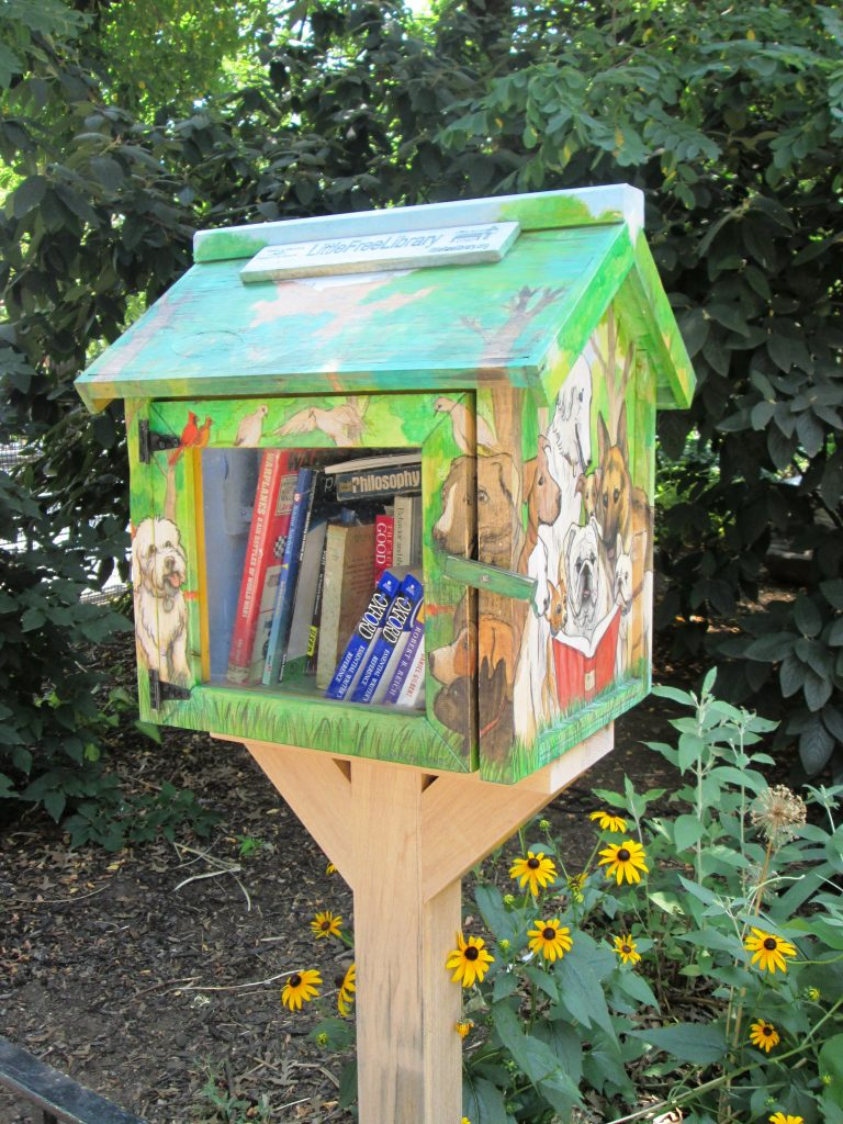 little free library with dogs painted on it