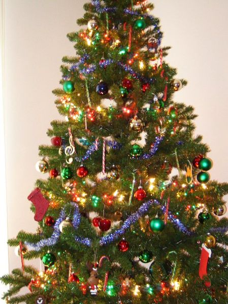 Tips for Making Your Imperfect Holiday a Happy One -- let the family decorate the tree, even if it does end up lopsided