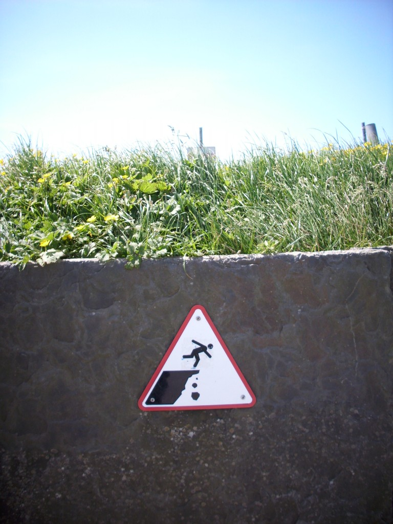 Beware of Cliff Edge sign -- handling stress
