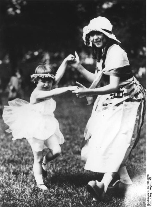old photo of two children dancing