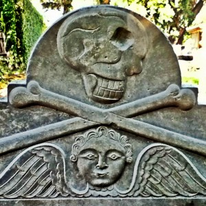 death head on tombstone