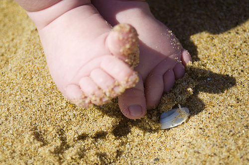 little kid toes in the sand