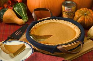 pumpkin pie surrounded by pumpkins