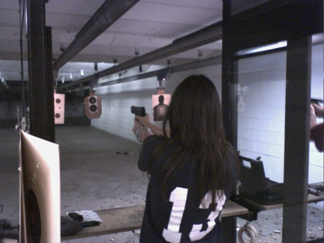 back of woman at shooting range