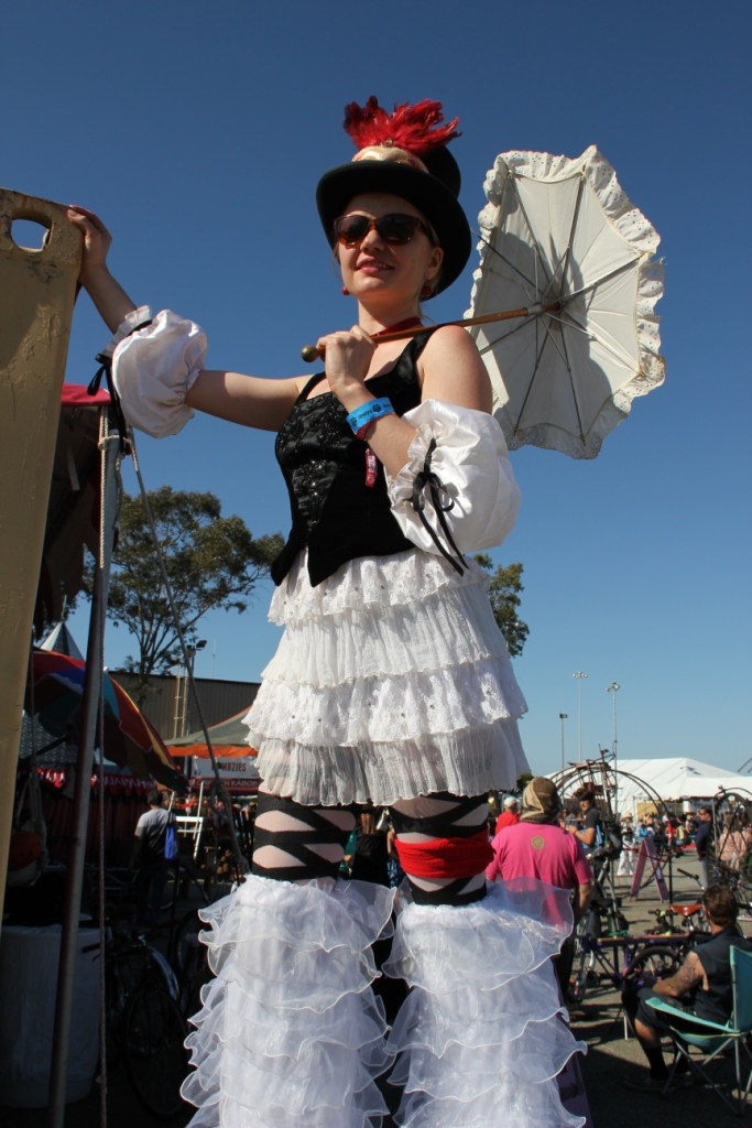 steampunker in corset on stilts