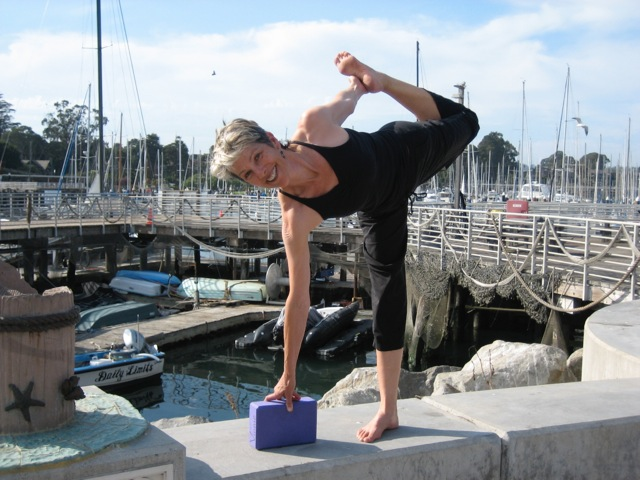 Vinnie doing a yoga pose on the Santa Cruz dock