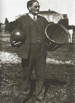Dr. Naismith, holding a ball and a farm basket.