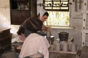 woman in costume making pottery
