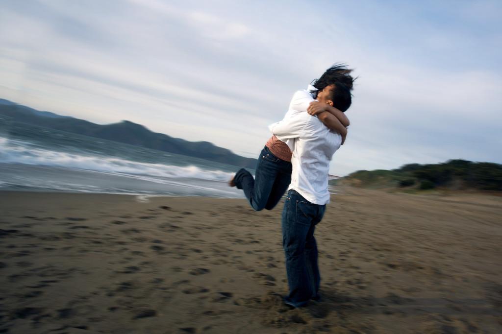 Couple hugging on a beach
