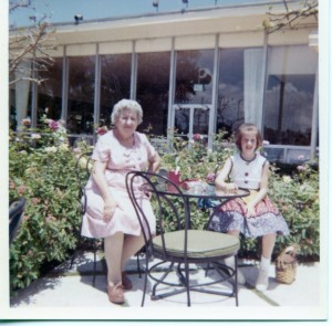 grandmother and me at a table