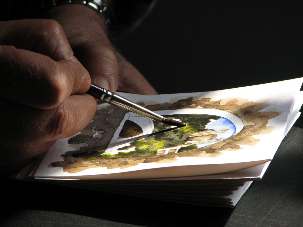 Artist painting in watercolors