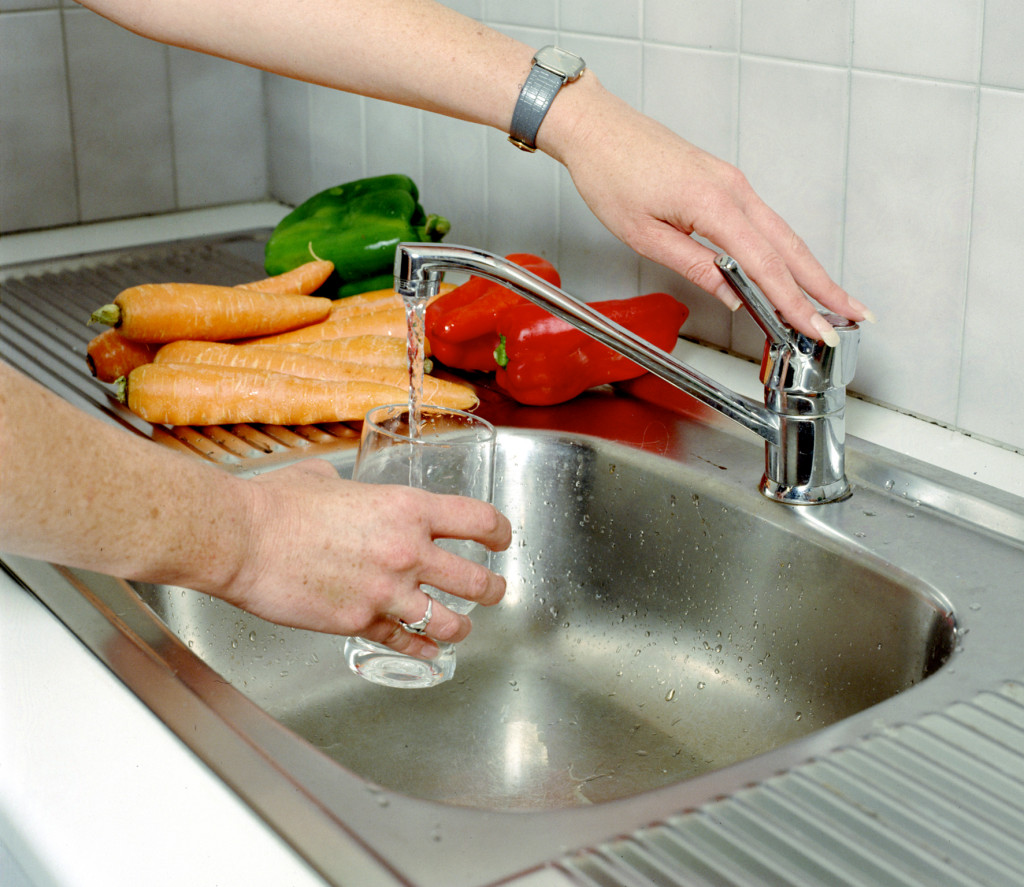 getting a glass of water at the sink
